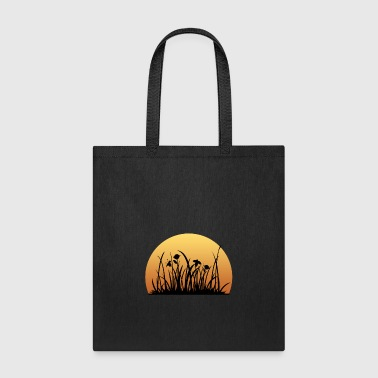 Meadow Sunset behind the meadow with the flowers - Tote Bag