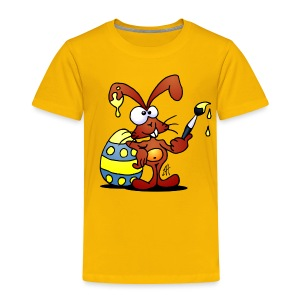 The Easter Bunny is painting an Easter egg - Toddler Premium T-Shirt