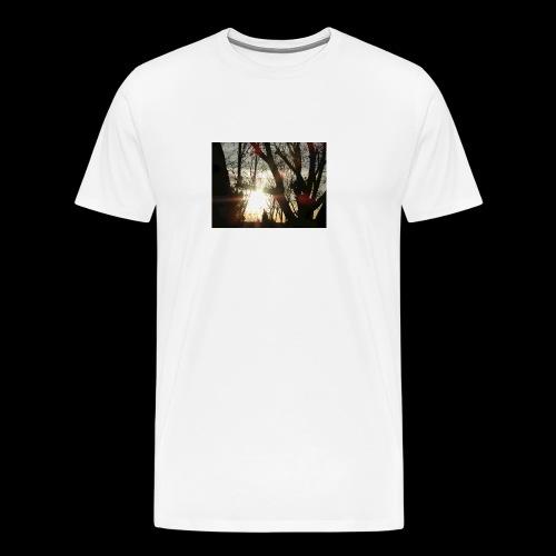 Bright sun rising through the trees in the desert - Men's Premium T-Shirt