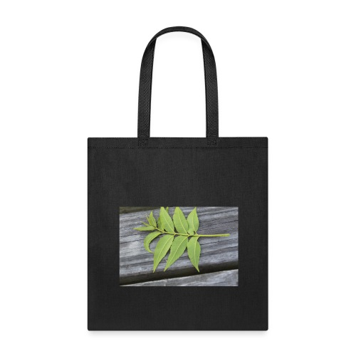 Leaf laying on the table - Tote Bag